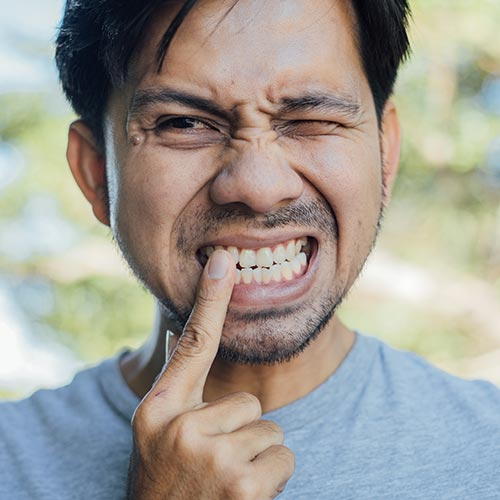 man in dental emergency