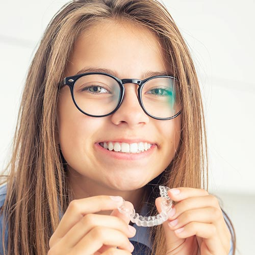 teenager with invisalign clear aligners
